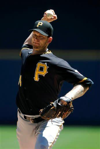 Pittsburgh Pirates' A.J. Burnett pitches against the Milwaukee Brewers during the first inning of a baseball game, Sunday, July 15, 2012, in Milwaukee. (AP Photo/Jim Prisching)