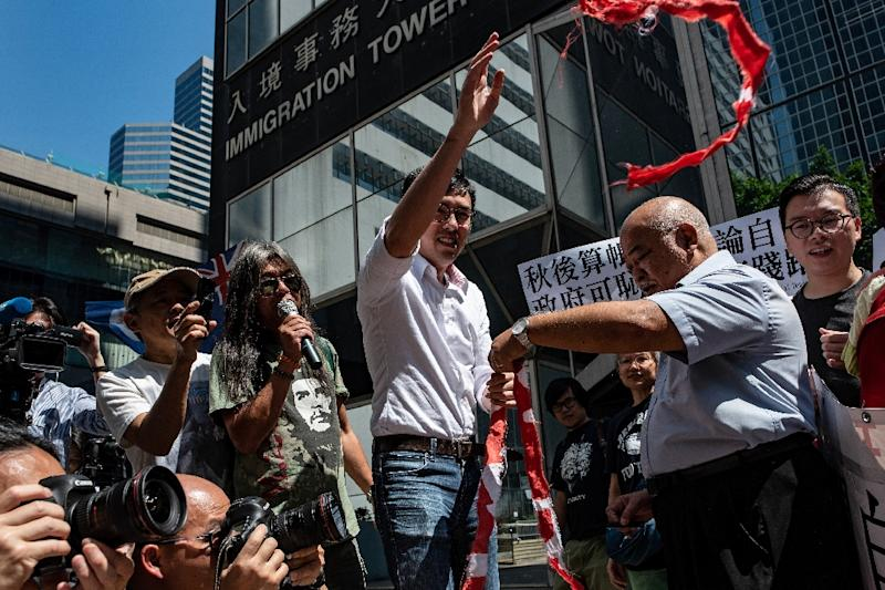 Protesters rally outside Hong Kong's immigration department after the city declined a visa renewal for senior Financial Times journalist Victor Mallet, prompting warnings over the erosion of freedoms in the former British colony (AFP Photo/Philip FONG)
