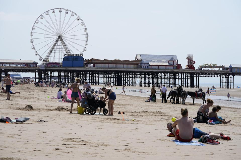 People enjoying the hot weather on Blackpool beach (Peter Byrne/PA) (PA Wire)