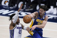 Indiana Pacers' Doug McDermott (20) passes the ball as Sacramento Kings' Richaun Holmes (22) defends during the second half of an NBA basketball game Wednesday, May 5, 2021, in Indianapolis. (AP Photo/Darron Cummings)