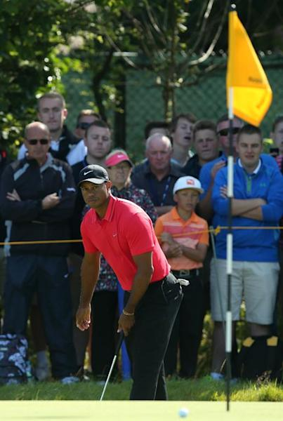 US golfer Tiger Woods reacts to a missed putt on the 4th green on the final day of the 2014 British Open at Royal Liverpool Golf Course in Hoylake, northwest England, on July 20, 2014 (AFP Photo/Andrew Yates)