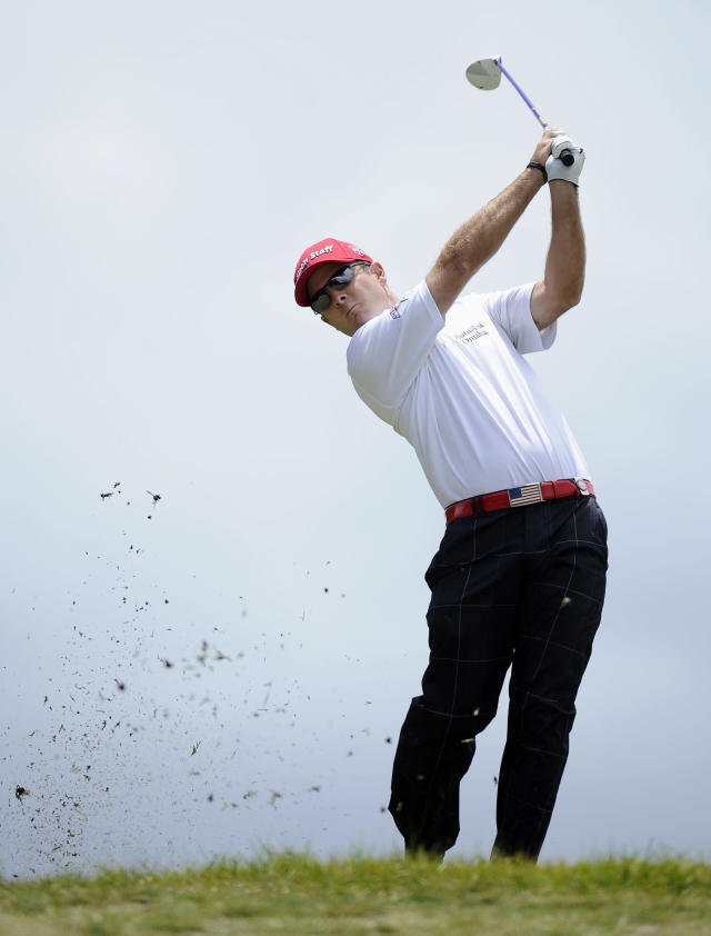 Kevin Streelman of the U.S. hits an approach shot on the second hole during the final round of the World Cup of Golf at Royal Melbourne Golf Course in Australia, Sunday, Nov. 24, 2013. (AP Photo/Andy Brownbill)