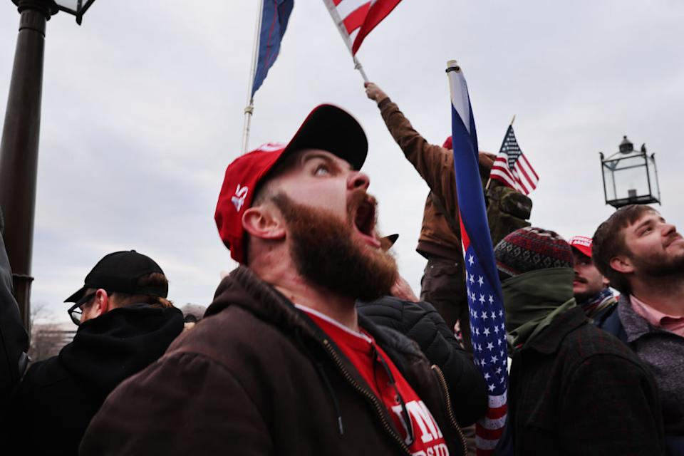 Thousands of Donald Trump supporters storm the United States Capitol building following a 'Stop the Steal' rally on in Washington, DC.