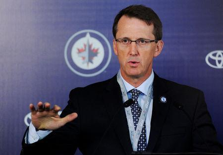 FILE PHOTO: Winnipeg Jets co-owner Mark Chipman answers questions at a news conference before the start of the Jets' season opening NHL hockey game against the Montreal Canadiens in Winnipeg, Manitoba, October 9, 2011. REUTERS/Todd Korol/File Photo