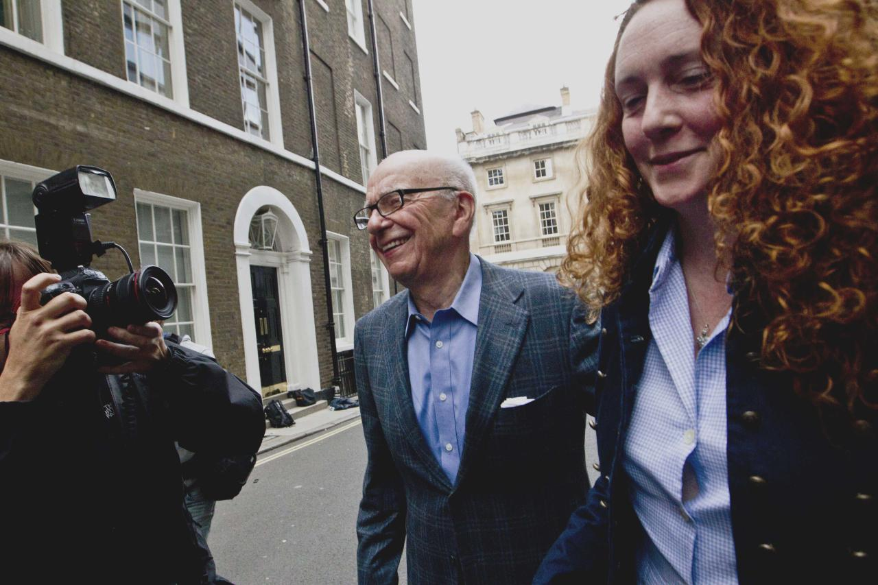 FILE In this Sunday, July 10, 2011 file photo Chairman of News Corporation Rupert Murdoch, left, and then chief executive of News International Rebekah Brooks leave his residence in central London. British police made six arrests early Tuesday March 13, 2012 in the British media's phone hacking scandal, including Rebekah Brooks, the former top executive of Rupert Murdoch's News International, The Associated Press has learned. (AP Photo/Sang Tan, File)