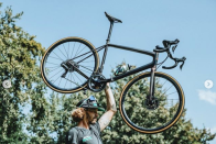 <p>Cyclists aren't known for their upper body strength, so we can presume that the hint here is the new bike is extremely light. </p>