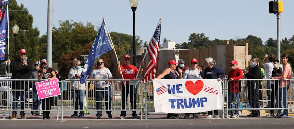 Trump supporters gathered outside Walter Reed National Military Medical Center on Sunday to show their support for President Donald Trump. (Photo: mpi34/MediaPunch /IPX)