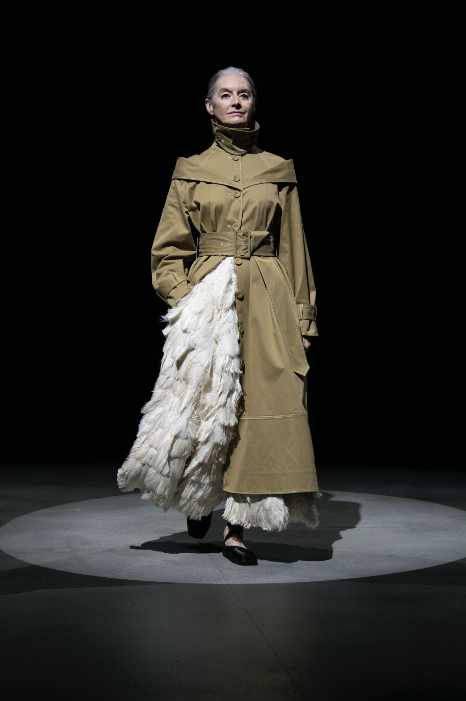 <p>This season, Erdem took us to the ballet—but it wasn't the tulle-skirted, blush-toned whimsy one would expect. Instead, we were taken backstage, on stage, in the wings, to rehearsals, and were even paid a visit from some ballet mistresses in strict tailoring. The designer looked at all sides of the art form, inspired by those in dance history that broke with convention. Margot Fonteyn, who danced with a partner almost two decades her junior in the '60s was a starting point for Erdem, who tapped four dancers past and present to walk on his collection stage. </p><p>Leggings, knits, and bralettes nodded to rehearsal dressing, while coats thrown over ostrich feather skirts were meant to feel like a dancer heading out after a performance with no time to change. There were some peacock moments as well: crystal-encrusted dresses, full skirts, and feathered headpieces called to the costumes of Swan Lake. Like many designers this season, Erdem seems to be reconsidering how we'll address dressing up post-lockdown; per his signature dark romance, his woman will do so elegantly—but with some edge. <em>—Carrie Goldberg</em></p>