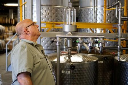 Herman Mihalich checks up on the most recent batch of rye whisky in his distillery in Bristol Pennsylvania