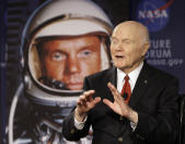 FILE - In this Feb. 20, 2012, file photo, U.S. Sen. John Glenn talks with astronauts on the International Space Station via satellite in Columbus, Ohio. Glenn's birthplace and childhood hometown in Ohio are celebrating what would have been the history-making astronaut and U.S. senator's 100th birthday with a three-day festival from July 16 through July 18, 2021. (AP Photo/Jay LaPrete, File)