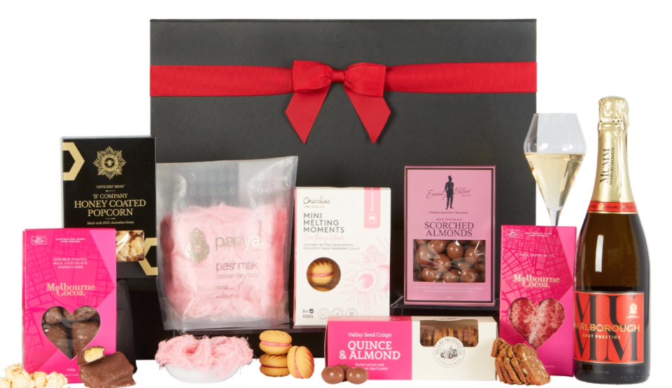 dessert box with chocolates, biscuits, fairy floss and a bottle of Mumm