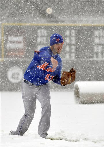 New York Mets pitcher Jeremy Hefner throws in the snow before a scheduled baseball game against the Colorado Rockies, Monday, April 15, 2013, in Denver. The game has been canceled. (AP Photo/Jack Dempsey)