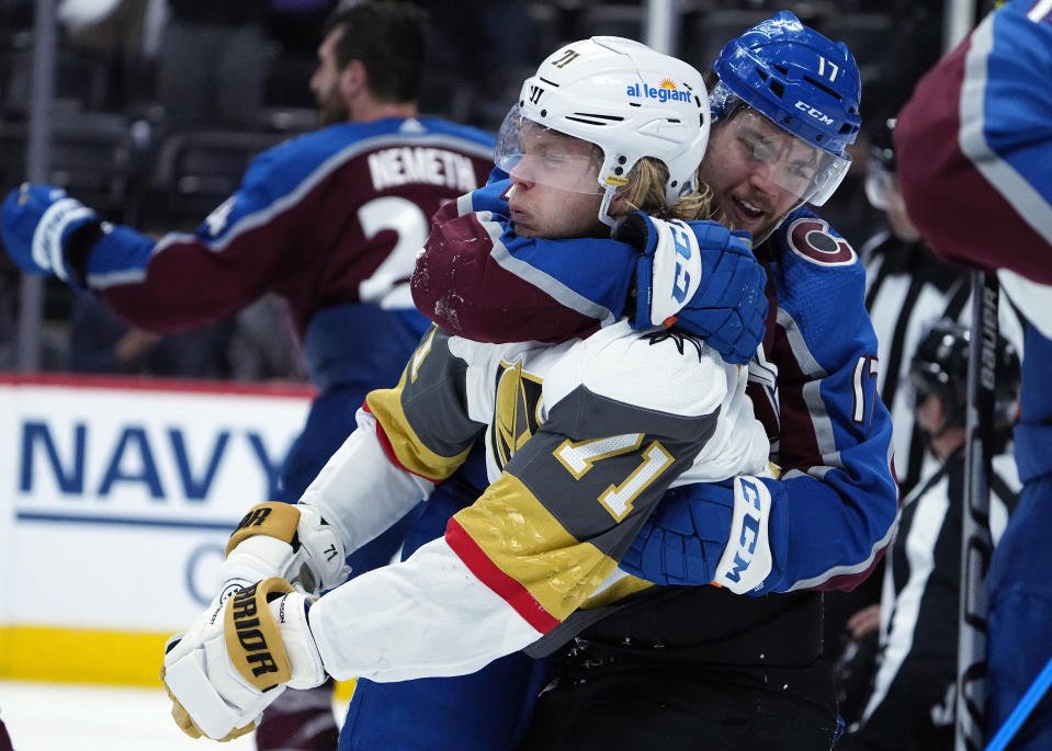 Colorado Avalanche center Tyson Jost (17) fights with Vegas Golden Knights center William Karlsson (71) in the third period of Game 1 of an NHL hockey Stanley Cup second-round playoff series Sunday, May 30, 2021, in Denver. (AP Photo/Jack Dempsey)