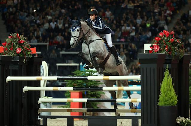 Equestrian - Sweden International Horse Show - International jumping - Qualification for Sweden Masters - Friends Arena, Stockholm, Sweden - December 1, 2017. Nicola Philippaerts of Belgium on his horse H&M Harley v. Bisschop jumps. TT News Agency/Soren Andersson/via REUTERS ATTENTION EDITORS - THIS IMAGE WAS PROVIDED BY A THIRD PARTY. SWEDEN OUT. NO COMMERCIAL OR EDITORIAL SALES IN SWEDEN