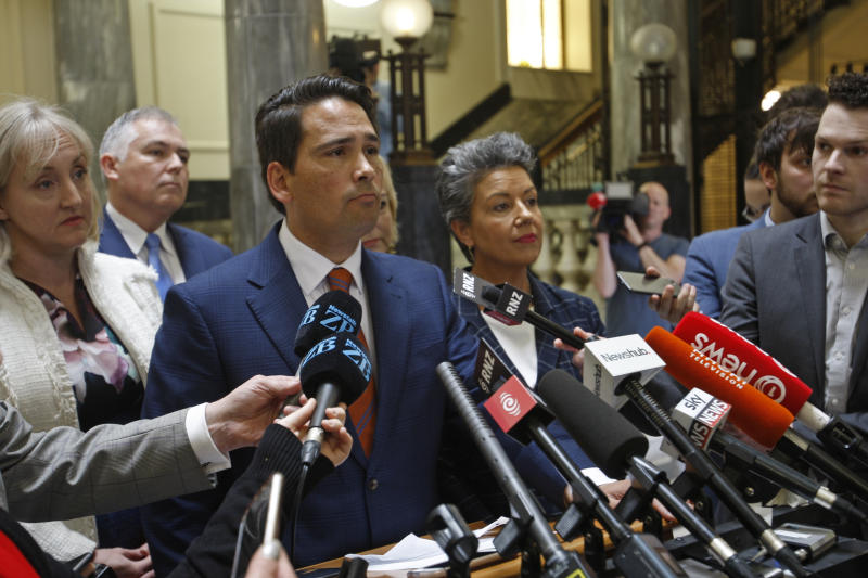 New Zealand opposition leader Simon Bridges speaks to reporters on Tuesday, Oct. 16, 2018, in Wellington, New Zealand. New Zealand's conservative opposition party was in turmoil after one of its own lawmakers, Jami-Lee Ross, accused Bridges of corruption for hiding a donation from a wealthy Chinese businessman.(AP Photo/Nick Perry)