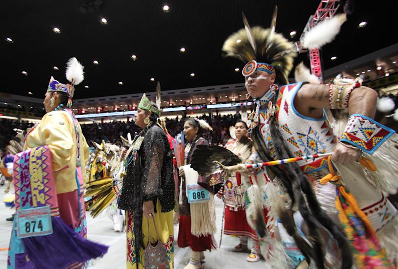 Hundreds of Native American and indigenous dancers pour onto the floor at University of New Mexico Arena for the grand entry during the 29th Annual Gathering of Nations in Albuquerque, N.M., on Friday, April 27, 2012. The event draws more than 3,000 dancers and singers and tens of thousands of spectators for three days of competitions and the crowning of Miss Indian World. (AP Photo/Susan Montoya Bryan)