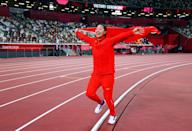 <p>Liu Shiying of Team China celebrates with the national flag after winning gold in the Women's Javelin Final. </p>