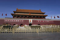 Chinese paramilitary policemen wearing face masks to help curb the spread of the coronavirus stand guard at the quiet Tiananmen Gate in Beijing, Sunday, Jan. 10, 2021. More than 360 people have tested positive in a growing COVID-19 outbreak south of Beijing in neighboring Hebei province. (AP Photo/Andy Wong)