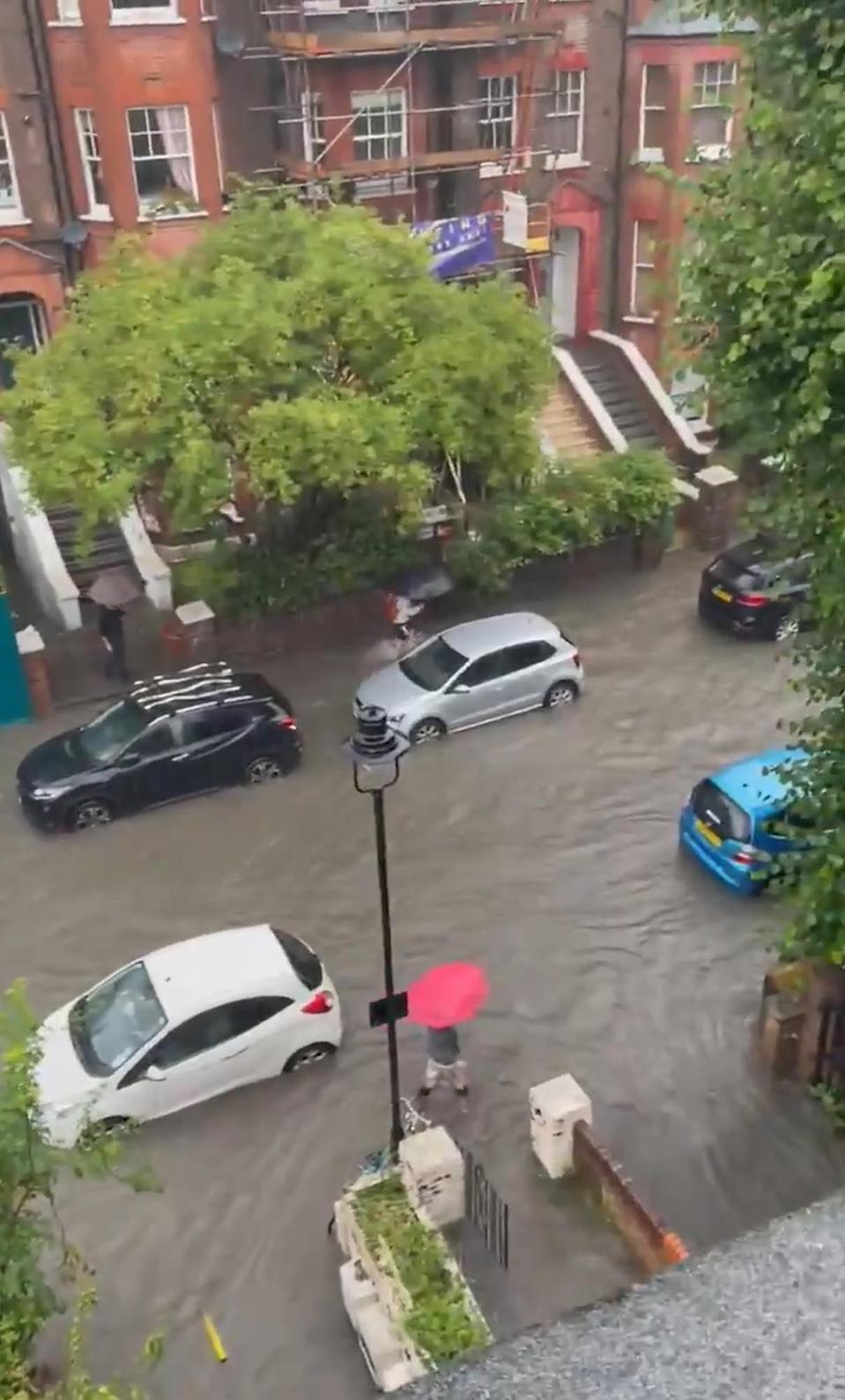 A flooded road in south Hampstead (PA Media)