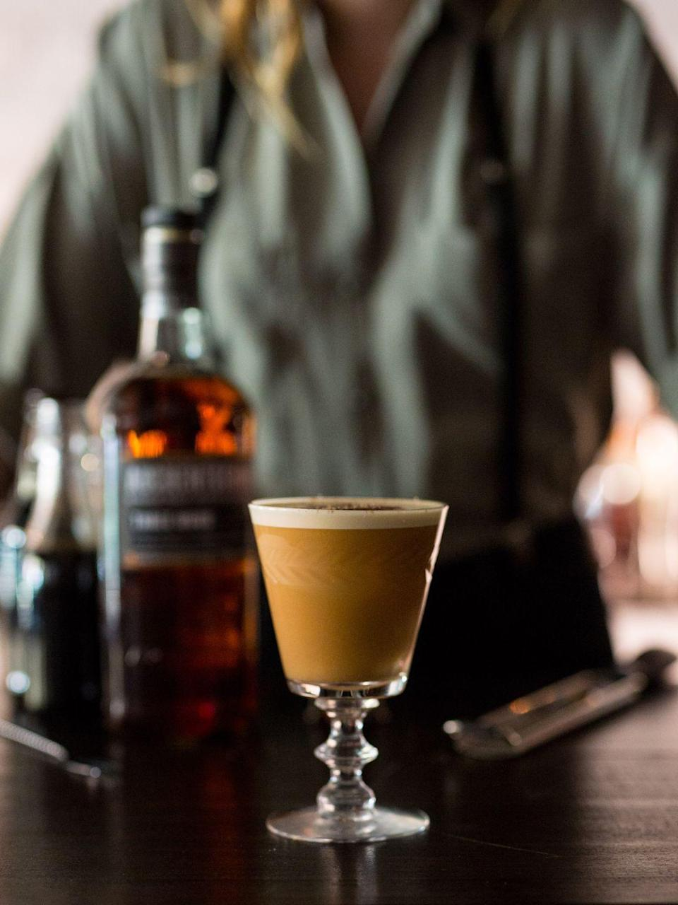 <p><strong>Ingredients</strong><br>2 oz Auchentoshan Three Wood Single Malt Scotch Whisky <br>1 oz chocolate stout <br>1 whole egg <br>4 dashes Peychaud's bitters <br>.5 oz brown sugar cayenne syrup* </p><p><strong>Instructions</strong><br>Add whisky, chocolate stout, whole egg, Peychaud's Bitters, and brown sugar cayenne syrup to cocktail shaker. Shake until egg is broken down and drink is frothy. Strain into footed rocks glass with fresh ice. Garnish with nutmeg.</p><p>*Brown sugar cayenne syrup: combine 2 cups light brown sugar, 1 cup water, and 2 tsp cayenne pepper in a saucepan over medium heat. Bring to boil. Let cool and keep in refrigerator.</p>
