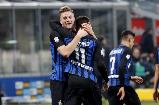 Inter Milan's Milan Skriniar, left, celebrates with his teammate Matias Vecino after scoring during the Serie A soccer match between Inter Milan and Benevento at the San Siro stadium in Milan, Italy, Saturday, Feb. 24, 2018. (AP Photo/Antonio Calanni)