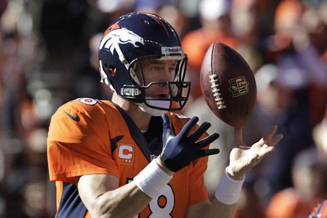 Denver Broncos quarterback Peyton Manning bobbles the ball on a bad snap during the first half of the AFC Championship NFL football game against the New England Patriots in Denver, Sunday, Jan. 19, 2014. (AP Photo/Joe Mahoney)