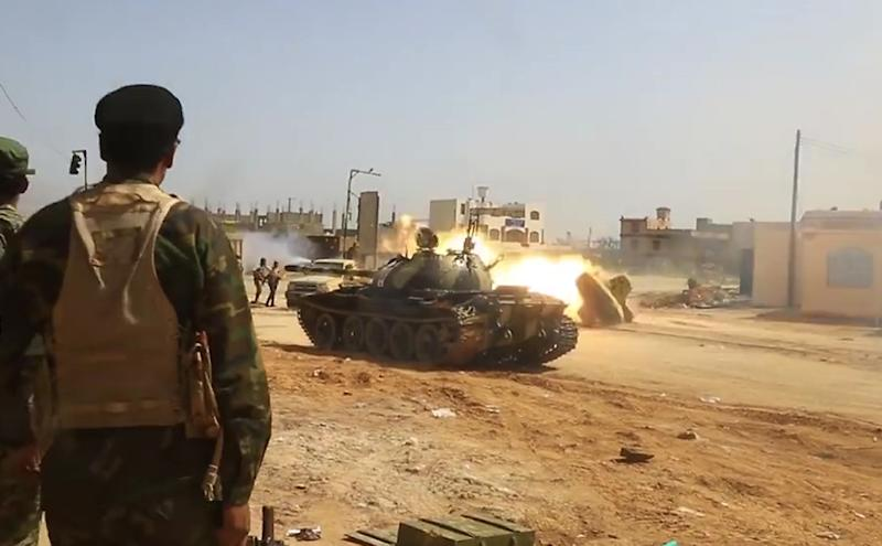 Image from a video published on the Libyan strongman Khalifa Haftar's self-proclaimed Libyan National Army War Information Division's Facebook page on April 16, 2019, shows a tank firing its turret reportedly in a southern suburb of the capital Tripoli. (AFP Photo/-)