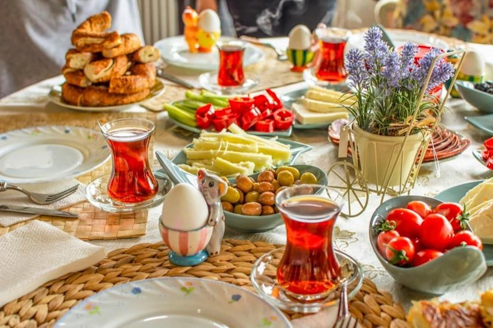 """<em>Suhoor </em>or <em>sehri</em> (among other names) is the morning meal Muslims eat before beginning their fast at dawn. The types of food people have for <em>suhoor</em> vary depending on their culture and their family—but since this is the only meal a person will have until sunset, complex carbs and something high in protein are typically included in order to prolong feelings of fullness. And of course, there is water—<a href=""""https://bestlifeonline.com/dehydration-and-the-body/?utm_source=yahoo-news&utm_medium=feed&utm_campaign=yahoo-feed"""" rel=""""nofollow noopener"""" target=""""_blank"""" data-ylk=""""slk:lots and lots of water"""" class=""""link rapid-noclick-resp"""">lots and lots of water</a>."""