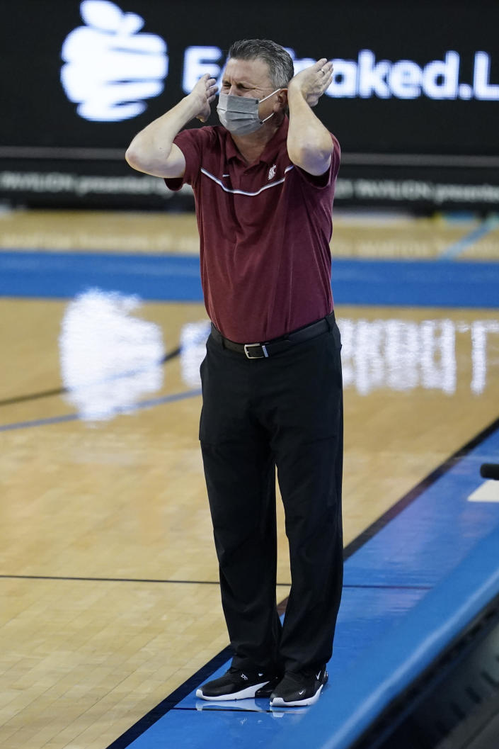 Washington State head coach Kyle Smith yells from the sideline during the first half of an NCAA college basketball game against UCLA, Thursday, Jan. 14, 2021, in Los Angeles. (AP Photo/Ashley Landis)