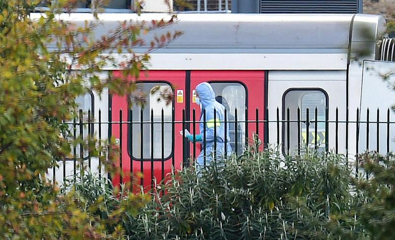 A forensic worker at the scene of the Parsons Green Tube bombing (PA)