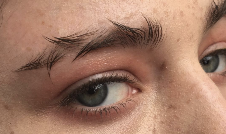 Brow art, including feathered brows pictured here, is everywhere right now.