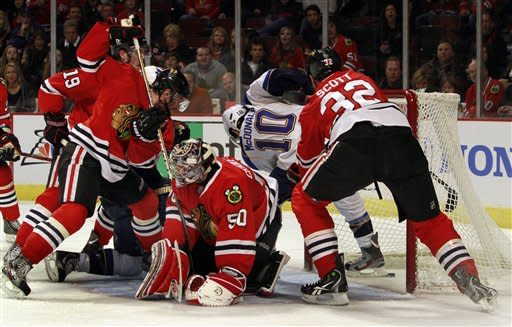 St. Louis Blues' Andy McDonald (10) scores the first goal against the Chicago Blackhawks during the first period of an NHL hockey game on Sunday, Feb. 19, 2012, in Chicago. (AP Photo/John Smierciak)