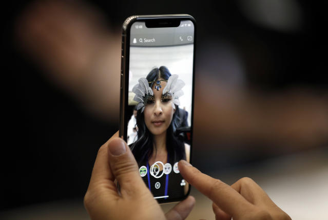 The new iPhone X is displayed in the showroom after the new product announcement at the Steve Jobs Theater on the new Apple campus on Tuesday, Sept. 12, 2017, in Cupertino, Calif. (AP Photo/Marcio Jose Sanchez)
