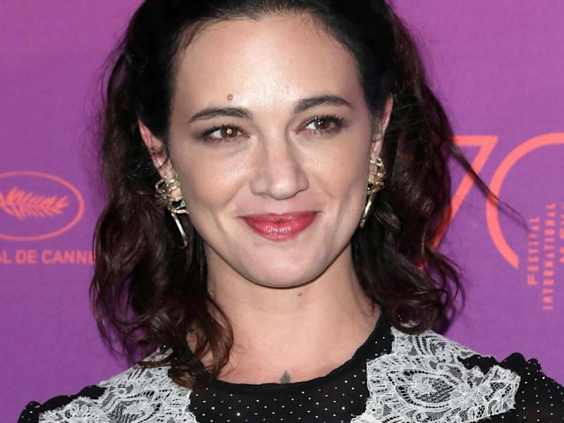 Asia Argento said she would return to Italy 'when things improve to fight alongside all the other women': Rex Features