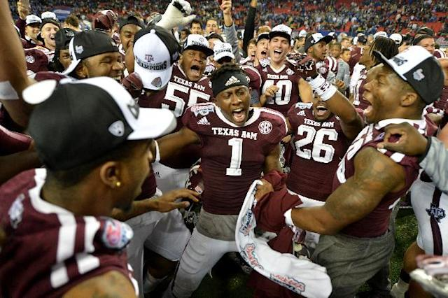 Texas A&M celebrates their win over Duke in the Chick-fil-A Bowl Tuesday Dec. 31, 2013, in Atlanta. (AP Photo/Atlanta Journal-Constitution, Brant Sanderlin)
