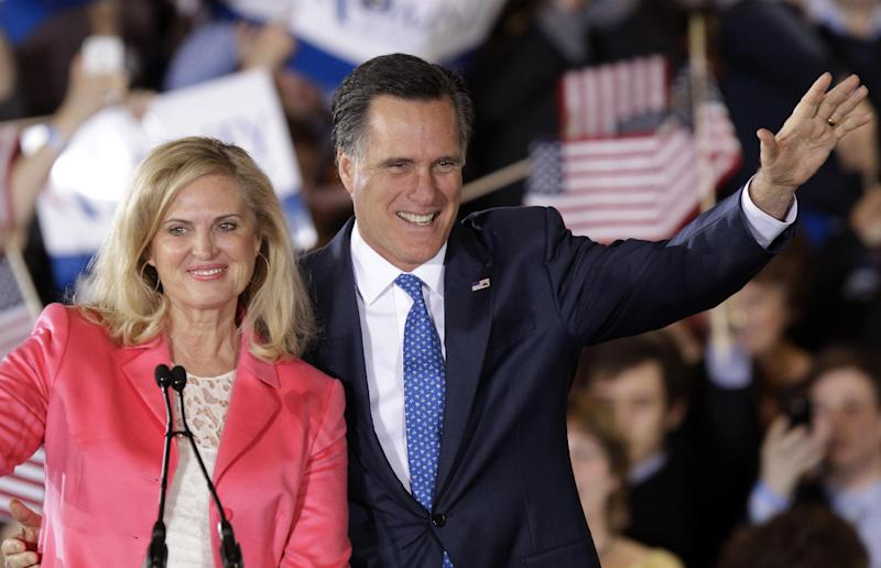 Republican presidential candidate, former Massachusetts Gov. Mitt Romney and his wife Ann wave to supporters at his Super Tuesday campaign rally in Boston, Tuesday night, March 6, 2012. (AP Photo/Stephan Savoia)
