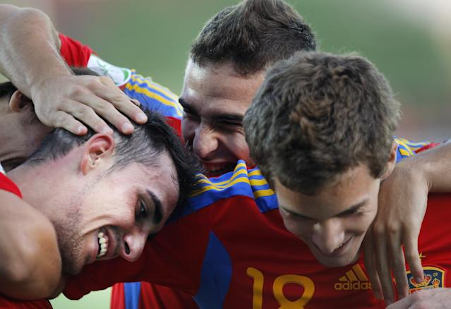 Pacol Alcacer (L) of Spain celebrates with colleagues after he scored 2-0 against Belgium during their UEFA European Under-19 Championship 2010/2011 football final tournament in Mogosoaia village, next to Bucharest on July 21, 2011. Spain won 4-1. AFP PHOTO/ STRINGER (Photo credit should read -/AFP/Getty Images)