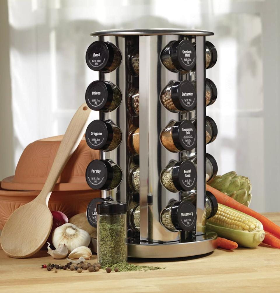 """Itcomes with labeled jars of spices filled with the spices themselves, as well as an online code so you can get free spice refills for FIVE years.<br /><br /><strong>Promising review:</strong>""""Oh, this was a perfect piece for my kitchen. I was looking for a spice rack for over a month and Wayfair had the one I needed. The size perfectly fits on my kitchen counter. Love this!"""" — <a href=""""https://www.anrdoezrs.net/links/8209452/type/dlg/sid/HPKitchenProductsDidntKnowExisted-60a3fc0fe4b063dcceaf8560-/https://www.wayfair.com/kitchen-tabletop/pdp/kamenstein-revolving-20-jar-spice-jar-rack-set-ktn1009.html"""" target=""""_blank"""" rel=""""noopener noreferrer"""">Van Doren</a><br /><br /><strong><a href=""""https://www.anrdoezrs.net/links/8209452/type/dlg/sid/HPKitchenProductsDidntKnowExisted-60a3fc0fe4b063dcceaf8560-/https://www.wayfair.com/kitchen-tabletop/pdp/kamenstein-revolving-20-jar-spice-jar-rack-set-ktn1009.html"""" target=""""_blank"""" rel=""""noopener noreferrer"""">Get it from Wayfair for $39.46.</a></strong>"""