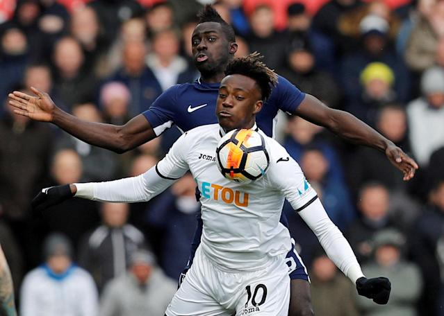 Soccer Football - FA Cup Quarter Final - Swansea City vs Tottenham Hotspur - Liberty Stadium, Swansea, Britain - March 17, 2018 Swansea City's Tammy Abraham in action with Tottenham's Davinson Sanchez REUTERS/Darren Staples TPX IMAGES OF THE DAY