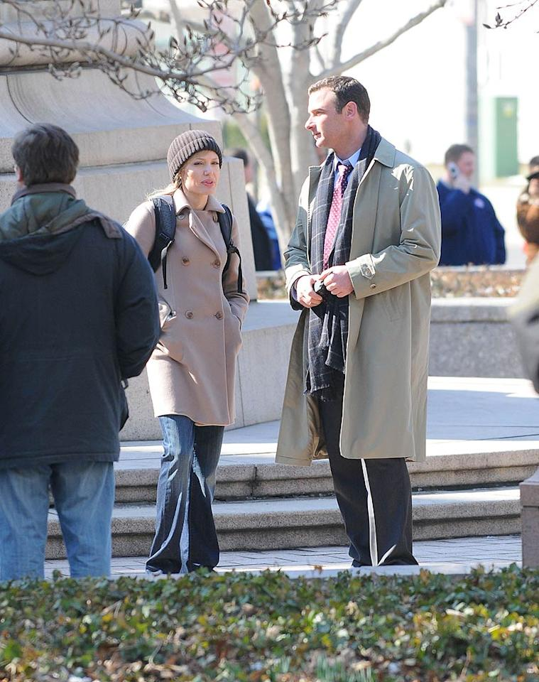 """Angelina Jolie and Liev Schreiber chat on the set of their upcoming thriller """"Salt"""" in Washington D.C. In the movie, Angelina plays a CIA agent that is outed as a Russian sleeper spy. Ron Asadorian/<a href=""""http://www.splashnewsonline.com"""" target=""""new"""">Splash News</a> - March 5, 2009"""