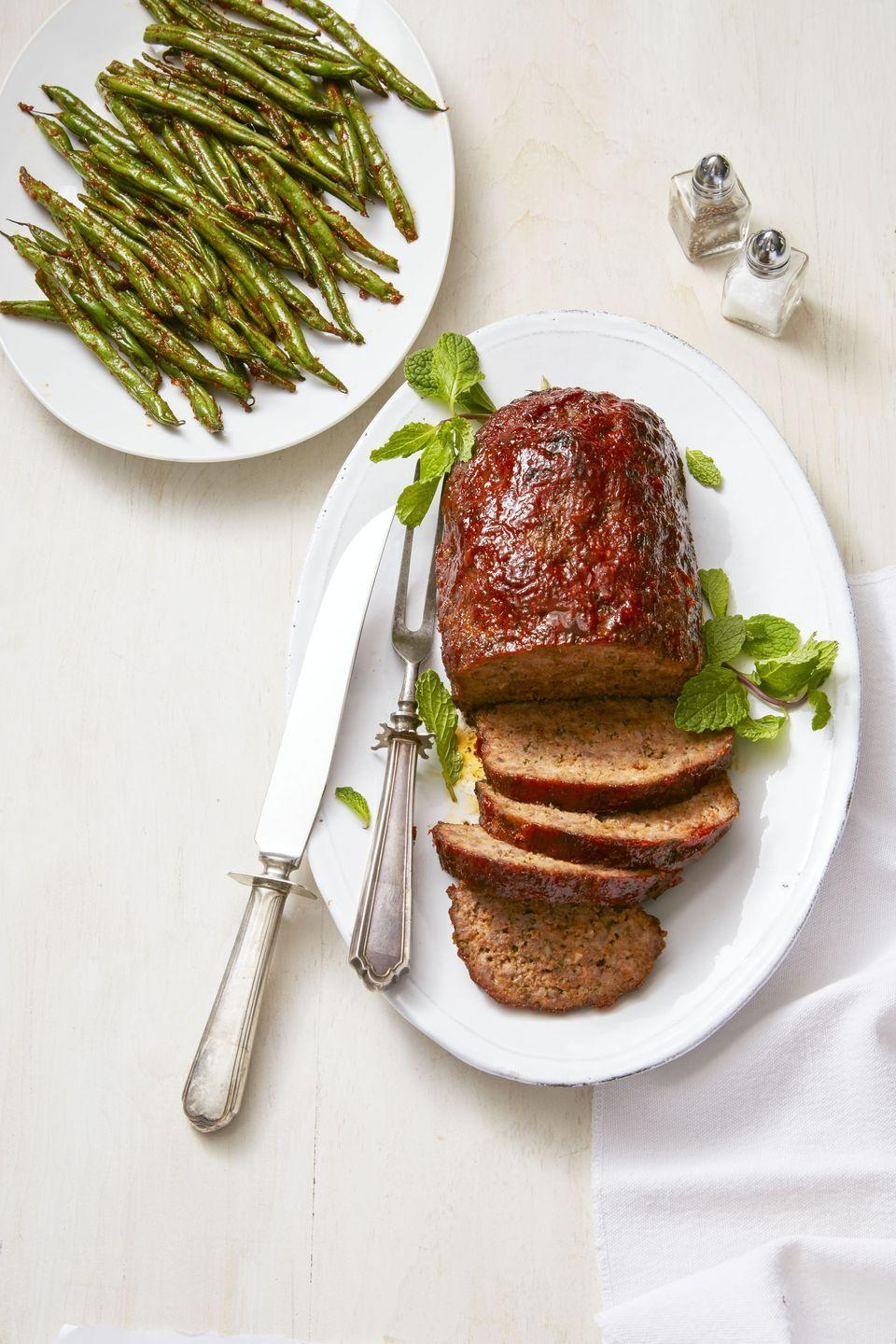 "<p>Gochujang (a Korean fermented chile paste) adds a mix of sweet, savory and sour so perfect that no one can accuse this dinner of being bland. </p><p><a href=""https://www.goodhousekeeping.com/food-recipes/easy/a36249/gochujang-glazed-meatloaf/"" rel=""nofollow noopener"" target=""_blank"" data-ylk=""slk:Get the recipe for Gochujang Glazed Meatloaf »"" class=""link rapid-noclick-resp""><span class=""redactor-invisible-space""><em><span class=""redactor-invisible-space""><span class=""redactor-invisible-space"">Get the recipe for Gochujang Glazed Meatloaf </span>»</span> </em></span></a><br></p>"