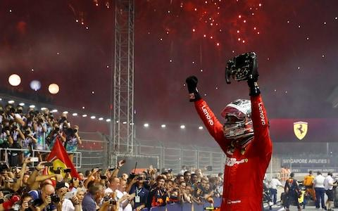 Formula One F1 - Singapore Grand Prix - Marina Bay Street Circuit, Singapore - September 22, 2019 Ferrari's Sebastian Vettel celebrates after winning the race - Credit:  REUTERS