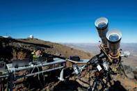 An astronomer prepares equipment ahead of a solar eclipse at the La Silla European Southern Observatory in Chile's Coquimbo region, on July 2, 2019