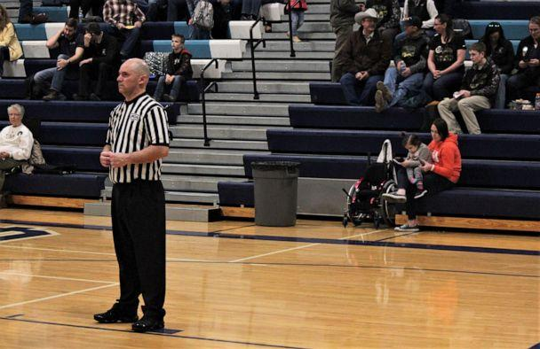 PHOTO: Finnley Foster watches her dad Pat Foster referee a high school basketball game in Great Falls, Montana, on Feb. 21, 2020. (MontanaSports)