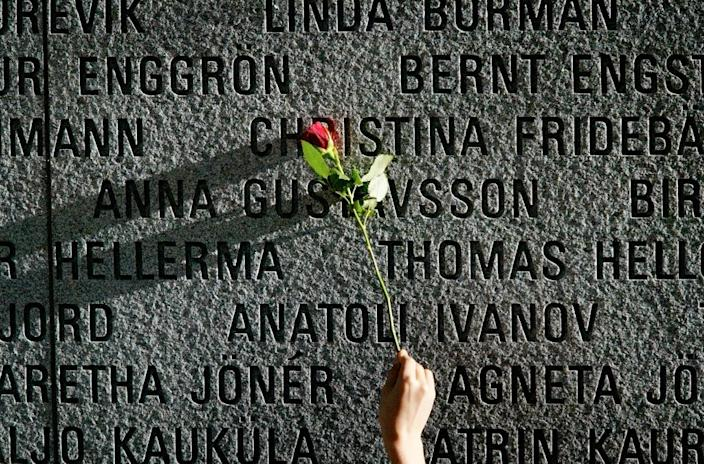 "A granite wall in Stockholm bears the names of the victims of the 1994 sinking of the ""Estonia"" ferry (AFP Photo/JESSICA GOW)"