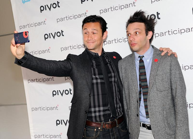 Actor, owner & founder of hitRECord, Joseph Gordon-Levitt, left, takes a photo with production partner Jared Geller at Participant Media's Pivot cable network launch event at the Museum of Arts & Design on Wednesday March 27, 2013 in New York. (Photo by Evan Agostini/Invision/AP)