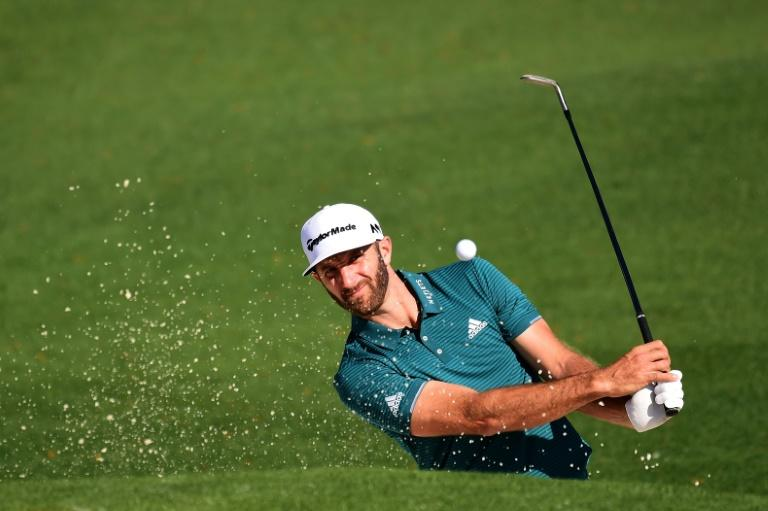 Dustin Johnson of the US plays a shot from a bunker on the second hole during a practice round prior to the start of the 2017 Masters Tournament, at Augusta National Golf Club in Georgia, on April 4