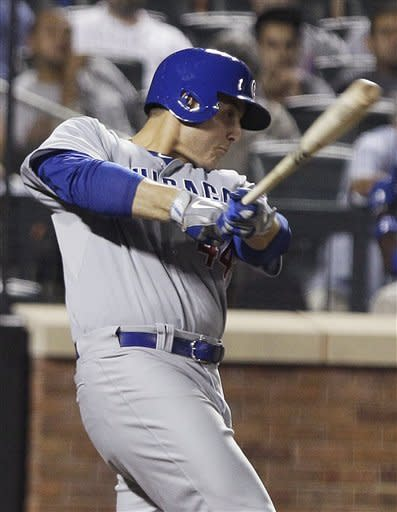Chicago Cubs' Anthony Rizzo follows through on a single during the eighth inning of a baseball game against the New York Mets on Friday, July 6, 2012, in New York. (AP Photo/Frank Franklin II)