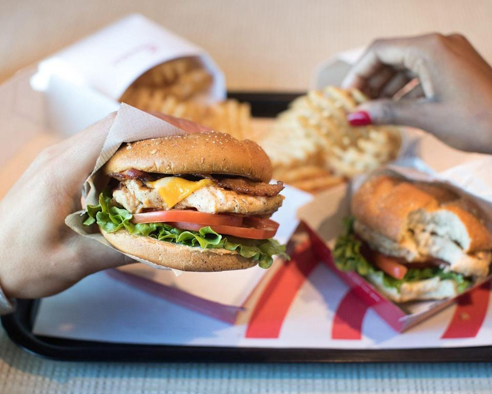 """<p>If you're not feeling fried, <a href=""""https://www.chick-fil-a.com/menu-items/grilled-chicken-sandwich"""" rel=""""nofollow noopener"""" target=""""_blank"""" data-ylk=""""slk:Chick-Fil-A's Grilled Chicken Sandwich"""" class=""""link rapid-noclick-resp"""">Chick-Fil-A's Grilled Chicken Sandwich</a> is the best alternative in the game. From it's smoky taste, to juicy grilled lemon-herb boneless chicken breast, this healthier option doesn't sacrifice taste. While most fast food grilled chicken can be left dry and overcooked, this sandwich defies the odds. </p>"""