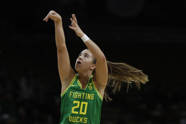 FLE - In this Feb. 1, 2020, file photo, Oregon guard Sabrina Ionescu (20) shoots in the first half of an NCAA college basketball game in Boulder, Colo. Ionescu was a unanimous choice Monday, March 23, 2020, as The Associated Press women's basketball player of the year. (AP Photo/David Zalubowski, File)